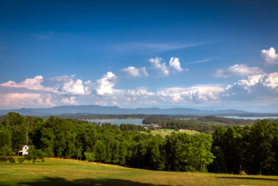 Jefferson County, TN scenery, blue skies, green rolling hills, view of the lake