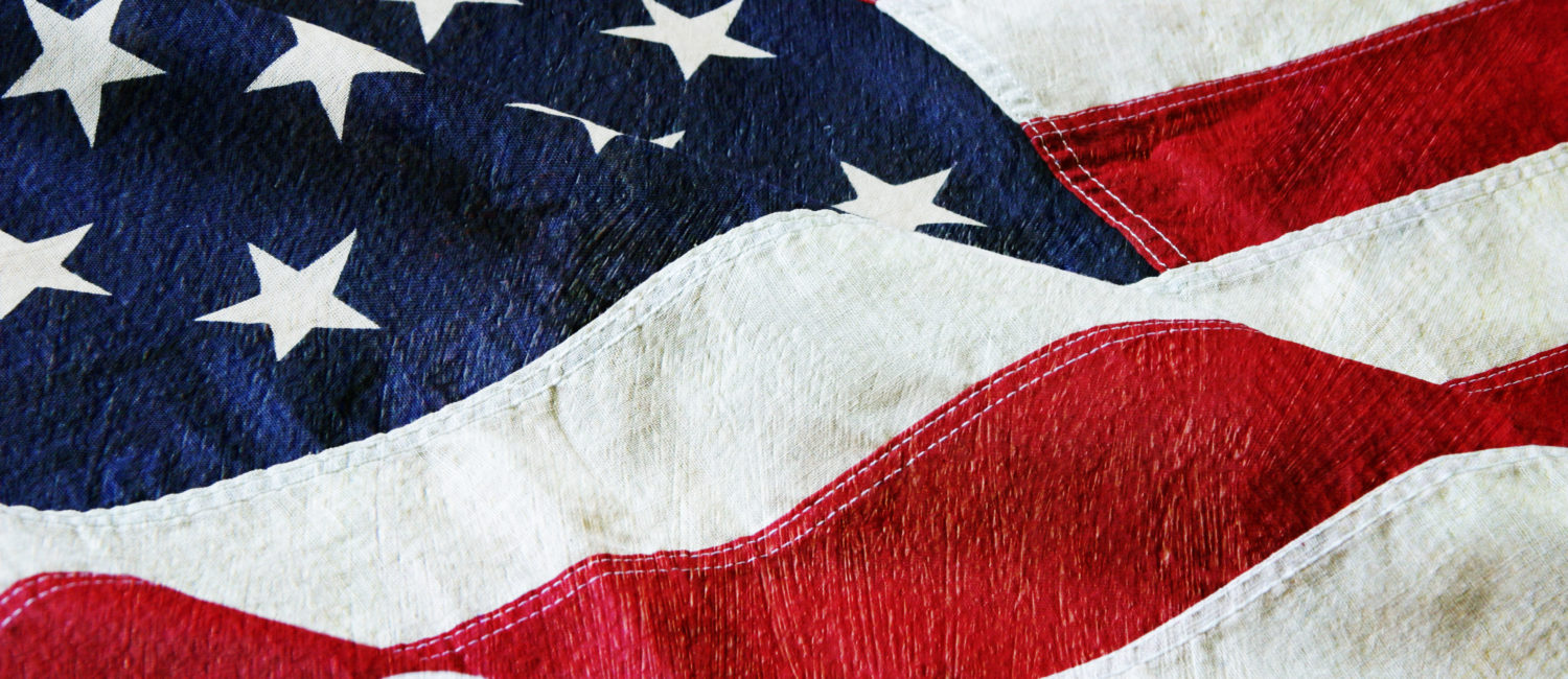 Detail of an American flag with a canvas and paint texture