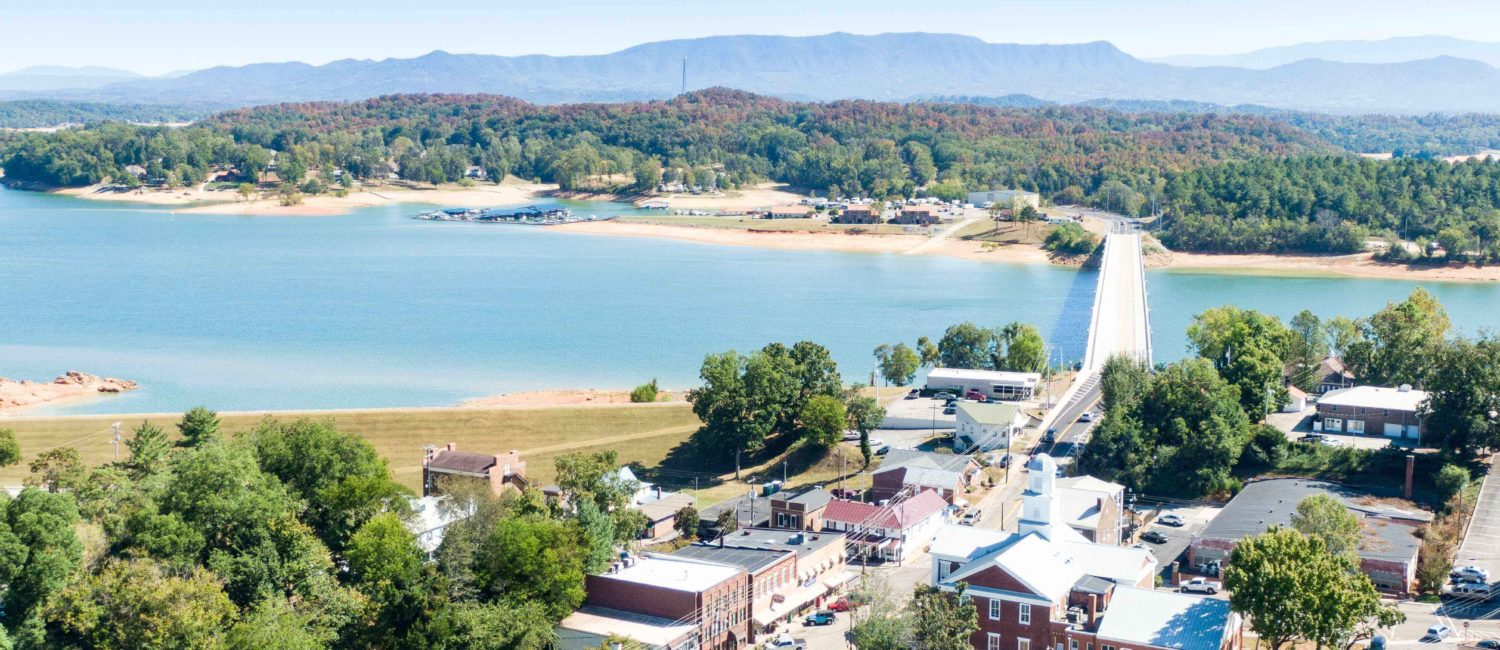 Aerial view of downtown Dandridge, TN, heading over Douglas Lake.