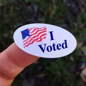 Person holding a voting sticker